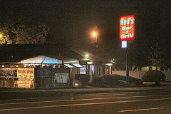 DAVID F. ASHTON - A long day came to a terrifying end at Reds Bar & Grill on Foster Road, when an armed man entered, fired shots at customers, and then robbed the place.