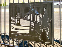 RITA A. LEONARD - Several laser-carved panels mounted on an Inner Southeast cast-iron fence, of which this is just one, depict Portland landmarks.