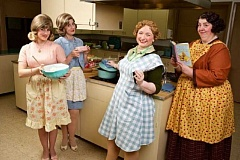 CRAIG MITCHELLDYER/BROADWAY ROSE THEATRE COMPANY - In the basement of the Tigard United Methodist Church, Broadway Rose 'church ladies' (from left) Zoe Randol as Signe, Debbie Hunter as Karin, Kymberli Colbourne as Mavis and Lori Paschall as Vivian ham it up with food prepared by Broadway Rose Guild members.