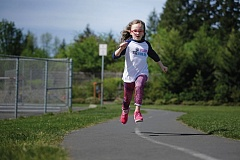 TIMES PHOTO: JONATHAN HOUSE - Bonny Slope student Ella Osborne is spearheading the 2016 Vision Fun Run that will be held on the track at her school. The Vision Fun Run will raise money to help get glasses to low-income families.