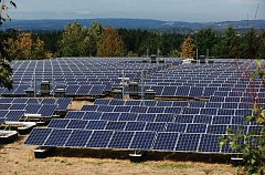 TIMES FILE PHOTO - Hundreds of solar panels now blanket the top of Sexton Mountain in southern Beaverton. The company managing the project is reorganizating under federal bankrupcy law, but the system remains operational.