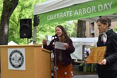 Merill Redisch, chairwoman of the Portland Urban Forestry Commission, says a few words about 2016 Maynard Drawson Memorial Award winner Catherine Mushel of Portland.