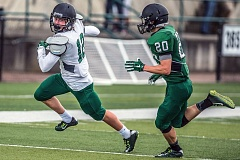 COURTESY RALPH GREEN - Matthew Mullen (left) of the White team tries to run away from Skylar Holloway of the Green team during the Tigard football programs annual Chicken and Beans Bowl on Saturday at Tigard High School.