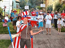 DAVID F. ASHTON - At a surprise party celebrating his new United States citizenship, Entertainer Henrik Bothe is crowned and robed, and sent to lead a parade around his block in Sellwood.