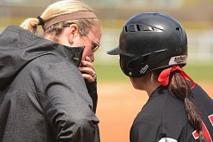 PAMPLIN MEDIA GROUP: DAVID BALL - Meadow McWhorter talks with Tiara Champ before an at-bat during Mt. Hood Community College's run to the Northwest Athletic Conference tournament title in May.