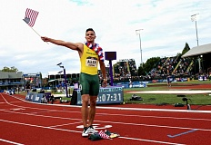 TRIBUNE PHOTO: DAVID BLAIR - Devon Allen of the Oregon Ducks waves to the home fans after winning his hurdles race.