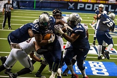 TRIBUNE PHOTO: DIEGO G. DIAZ - Fullback Kevin Myers bangs off teammate/offensive lineman Leonardo Bates on the way to a seven-yard touhdown run for the Portland Steel. Portland took the Orlando Predators down to the wire at Moda Center on Saturday before losing 47-41 to the team with the best record in the Arena Football League.