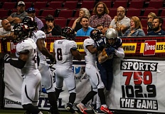 TRIBUNE PHOTO: DIEGO G. DIAZ - The Orlando Predators defense can't shake Portland Steel receiver Tom Gilson from a first-half catch Saturday night at Moda Center.