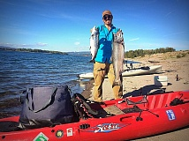 PAMPLIN MEDIA GROUP PHOTO: JO OSTGARDEN - Tyler HIcks uses a kayak to fish for salmon on the Columbia River.