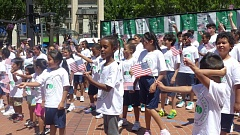 TRIBUNE PHOTO: MICHAELA BANCUD - At Thursday's draw ceremony in Pioneer Courthouse Square, members of the Portland After School Tennis program in North Portland show their support for the U.S. team and the Davis Cup quarterfinal with Croatia set for Friday-Sunday at Tualatin Hills Tennis Center.