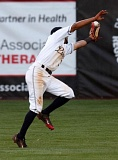 TRIBUNE PHOTO: JONATHAN HOUSE - Sahid Valenzuela, Portland Pickles shortstop, makes a twirling catch of a pop up into left-center field to end a Marysville Gold Sox threat in the sixth inning Friday night at Walker Stadium.