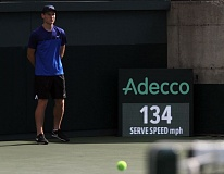 TRIBUNE PHOTO: MILES VANCE - The speed of a John Isner serve registers at 134 mph during Friday's Davis Cup play at Tualatin Hills Tennis Center.