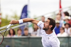 TRIBUNE PHOTO: JAIME VALDEZ - Marin Cilic serves to John Isner in their Davis Cup singles match, won in straight sets by Cilic on Sunday afternoon at Tualatin Hills Tennis Center.