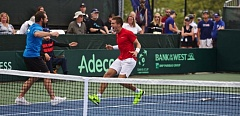 TIMES PHOTO: JAIME VALDEZ - Croatia's Borna Coric (right) and Captain Zeljko Krajan come together after Coric's four-set win over Jack Sock on Sunday at Tualatin Hills Tennis Center clinched the Davis Cup quarterfinal for their team.