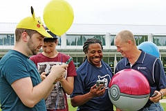 TRIBUNE PHOTO: LYNDSEY HEWITT - Staff at Concordia University have embraced the 'Pokemon Go' trend. They recently gathered to tie Pokemon-themed balloons to each of their 14 Pokestops to make it even easier for players to spot.