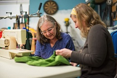 COURTESY: CITY OF PORTLAND BPS - Marie Corell (right) is a volunteer sewer for Repair PDX, where she helps people mend their favorite items -- from purses to jeans.