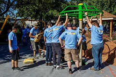 HILLSBORO TRIBUNE: TRAVIS LOOSE - Volunteers built a new playground at Hillsboro's McKinney Park on Thursday as part of a national program to increase play.