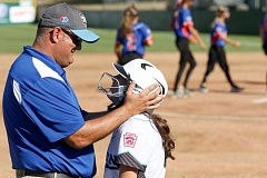 TRIBUNE PHOTO: JONATHAN HOUSE - Coach Matt Sorenson gives a pep talk to Liliana Gaitan of the Lincoln/Southwest Portland team during Monday's game at Alpenrose Stadium.