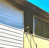 COURTESY OF CLACKAMAS FIRE DISTRICT #1 - This photo, taken from the ground next to the Lake Road apartment building, shows the top-floor fire room's charred window.