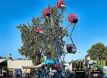 DAVID F. ASHTON - After requiring a minor repair, the Oaks Amusement Parks Rock-O-Plane is again thrilling young and old.
