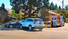 DAVID F. ASHTON - AMR ambulance paramedics prepare to transport a patent, after a Honda CRV broadsided a Tesla at the blind corner on Bybee Boulevard at S.E. 14th Avenue.