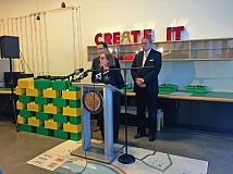 PAMPLIN MEDIA GROUP: PARIS ACHEN - Gov. Kate Brown announced a $100 million settlement of the Oracle feud over Cover Oregon debacle on Thursday at OMSI, flanked by Deputy General Counsel Misha Izaak (left), and Department of Adminstrative Services Chief Information Officer Alex Pettit.