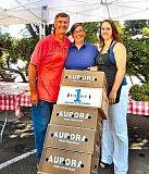 ELIZABETH USSHER GROFF - Woodstock Farmers Market vendor Frank Battilega donates stacks of boxes of leftover produce to Neighborhood Gleaners. Jen and Heather Keislerfornes, founders of Neighborhood Gleaners, help haul the contributed food to low-income families and seniors.