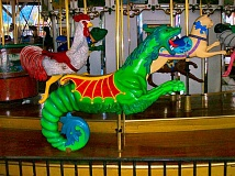 RITA A. LEONARD - This ride-able green dragon is a fixture on the carousel at Oaks Amusement Park.