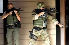 COURTESY PHOTO: ROSEBURG NEWS-REVIEW - Douglas County and Roseburg law enforcement officers searched buildings on the Umpqua Community College campus after the Oct. 1, 2015, shooting that killed nine people, including the gunman. A state work group has recommended ways to improve safety on college campuses across the state.