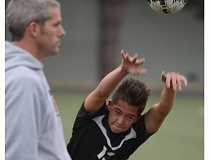 SANDY POST: DAVID BALL - Sandys Kyler Kim makes a throw-in under the eye of head coach Garet Luebbert during a match earlier this season. The Pioneers moved to 5-1-1 with a win at 6A Sprague this week.