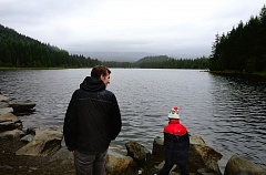 SUBMITTED PHOTO - Passport Oregon's Kevin Frazier (left) and Miguel - a member of Passport Oregon's first cohort from the Creston neighborhood in Portland - glance at a cloud-covered Mount Hood behind Trillium Lake on Sept. 17.