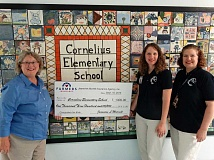COURTESY PHOTO - (Left to right) Cornelius Farmers Insurance agent Jeannine Murrell presented Cornelius Language Development teacher Melissa Timm and Cornelius Elementary School Principal Angella Graves with a $1,300 donation this month.