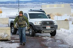 COURTESY PHOTO: JOHN SEPULVADO/OPB - An FBI guard guides a truck out of the compound near the Burns Airport during the 41-day occupation of the Malheur National Wildlife Refuge.