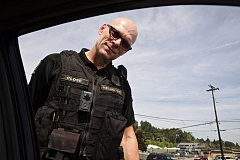 PAMPLIN MEDIA GROUP FILE PHOTO - Portland Police Officer Michael Close wears a camera on his uniform while making a traffic stop in 2015. Officers in Hillsboro, North Plains and Sherwood could begin wearing similar cameras soon, thanks to a grant from the Department of Justice.