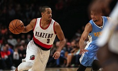 TRIBUNE PHOTO: DAVID BLAIR - Trail Blazers guard CJ McCollum looks to penetrate against the Denver Nuggets during an NBA exhibition game Sunday night at Moda Center.