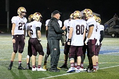 REVIEW/NEWS PHOTO: JIM BESEDA - Milwaukie coach Jon Wolf talks with the Mustangs' offense during a timeout at the Oct. 7 road game against La Salle Prep.