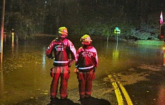 PAMPLIN MEDIA GROUP: DAVID F. ASHTON - Portland firefighters survey a flooded Sellwood street during Friday night's downpours. Two tropical storms blasted the region, leaving flooded streets, power outages and damaged trees in its wake.