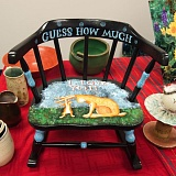 OUTLOOK PHOTO: JOSH KULLA - Sharon Jones takes garage sale finds, refurbishes them and uses artwork and phrases from beloved children's books to create  keepsakes like this chair.