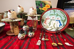 OUTLOOK PHOTO: JOSH KULLA - Painter Sharon Jones applies faux snow and playful snowmen on baby spoons she finds at local garage sales.