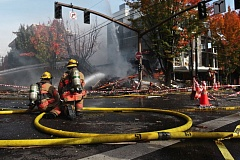 PORTLAND TRIBUNE: JAIME VALDEZ - Portland firefighters hosed down what was left of a building at the corner of Northwest 23rd Avenue and Glisan Street Wednesday morning, nearly two hours after a natural gas explosion rocked the area.