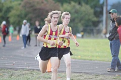 NEWS-TIMES PHOTO: WADE EVANSON - Max and Quincy Norman running for Forest Grove.