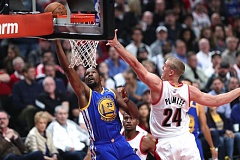 TRIBUNE PHOTO: JAIME VALDEZ - Kevin Durant (left), driving to the basket against Trail Blazers center Mason Plumlee, adds to the depth of talent on the Golden State Warriors.