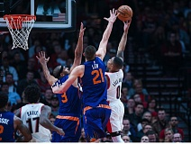 TRIBUNE PHOTO: JOHN LARIVIERE - Trail Blazers guard Damian Lillard tries to extend for a driving shot against the Phoenix Suns.