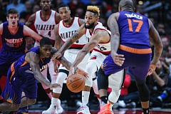 TRIBUNE PHOTO: JOHN LARIVIERE - Trail Blazers guard Allen Crabbe battles for possession against Phoenix on Tuesday night at Moda Center.