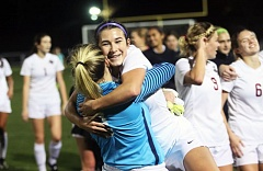 DAN BROOD - Sherwood seniors Madison Reimer (left) and Cameron Greene hug following the Lady Bowmen's 3-2 win over West Linn in Tuesday's Class 6A state semifinal match.