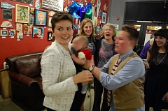 PHOTO BY RAYMOND RENDLEMAN - Milwaukie City Councilor Karin Power, whose wife, Megan Elston, is pictured taking over care for their newborn son Grady at a Nov. 8 election party, easily won election to a seat as state representative.
