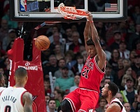 TRIBUNE PHOTO: JOSH KULLA - Chicago Bulls forward Jimmy Butler dunks on his way to 27 points Tuesday night in a 113-88 win over the Trail Blazers at Moda Center.