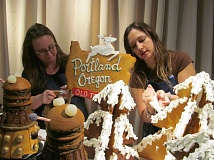 PHOTO BY ELLEN SPITALERI - Sarah Moyle, left, and Rachel Ciula, owner of Delice Chocolates and Confections, pipe frosting onto the set pieces of GingerTardis, on display now as part of Gingerbread Adventures at OMSI.