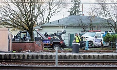 OUTLOOK PHOTO: JOSH KULLA - A vehicle crash at the Ruby Junction MAX station this afternoon has snarled traffic along Burnside Street as Trimet and Gresham Police investigate and clean up the mess.