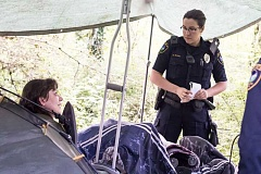 FILE PHOTO - Officer Heather Wakem speaks with local homeless residents.